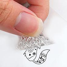 Peel small clear stamps from transparent sheet.